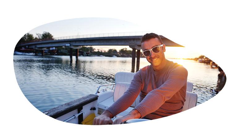 Man in sunglasses sitting in a boat